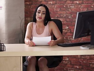 Naughty brunette Chloe Lovette climbs onto the table during working day